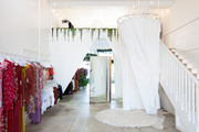 A retail store with Bohemian accents and white walls.