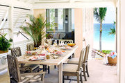 An outdoor dining area with views of the Caribbean