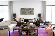 A well-worn purple rug brings a pop of color to a living room