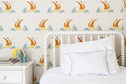 Colorful sailboat wallpaper in a children's bedroom