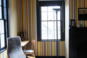 Shades of yellow and gray in a guest bedroom