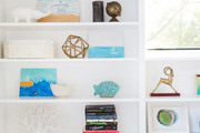 A detail of some blue, gold, and white shelving decor.