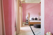 Pink walls in a spacious guest room