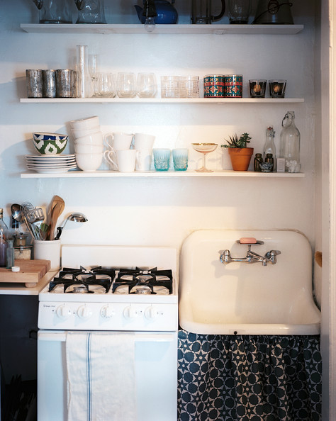 Skirted Sink Kitchen : Wall Shelves - A skirted sink and open shelves with glassware and ...