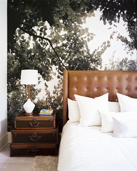 Wallpaper  - Nature-inspired wallpaper paired with a leather headboard and stacked luggage