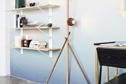 Shelving and a geometric floor lamp