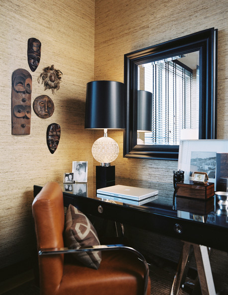 Work Space - A leather chair and a black sawhorse desk in an office area with glass-cloth wallpaper