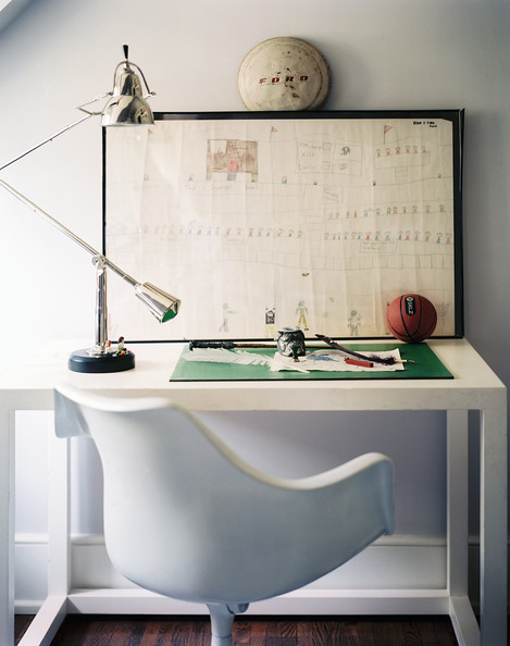Work Space - A white desk with a silver task lamp