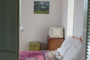 Colorful linens in a pared-down guest room