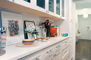 White cabinetry and a penny-tile backsplash in a kitchen