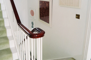 Framed art in a stairway with green carpeting
