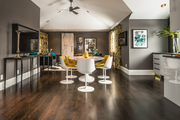 Contemporary brown, gray, and yellow dining area.