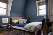 Lonny Senior Associate Editor Sean Santiago's Brooklyn bedroom makeover features a new smokey blue wall color and a patterned DIY headboard.