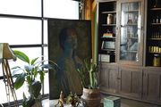 Artwork id displayed in a green room with lots of greenery,