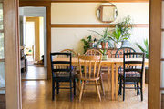 A view into a traditional dining space with mis-matched chairs.