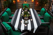 An outdoor table with a custom runner, Moroccan lanterns, tea lights, and succulent pots on Irene Edwards's rooftop patio