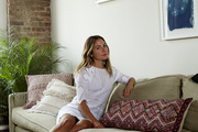 Kim Ficaro lounging in the living room of her Brooklyn apartment
