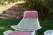 An cushioned chaise in the garden