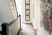 A hallway with a zebra-print runner