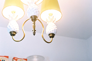 A vintage pineapple-motif chandelier with yellow shades