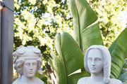 White sculptures on outdoor patio.