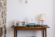 Patterned floor pillows beneath an antique console table