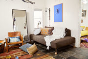 Multi patterned throw pillows highlight the neutral colored furniture.