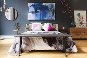 A bench at the foot of a bed in The Bedroom designed by Athena Calderone for CB2