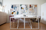 A studio space with white walls and desks.