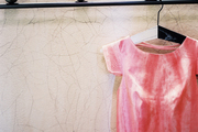 A pink dress on a hanger