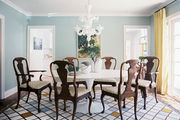 Wood dining chairs surrounding a white tulip table