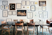 A collection of art in a dining space