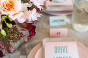 An overhead of a tablescape with pink plates.