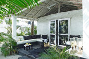 The front porch of fashion designer Laurence Dolige's tropical beach house