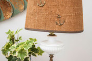 A vintage lamp with a nautical shade