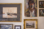 A grouping of framed art hung on a wall