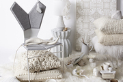 Decor items in a pared-down palette of white on white