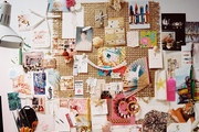 An inspiration board of pattern and color beside a white desk lamp