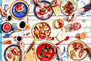 An overhead shot of a colorful brunch tablescape