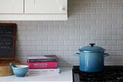 An AGA oven with a backsplash of white subway tile