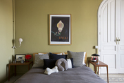 Throw pillows atop a bed flanked by night tables