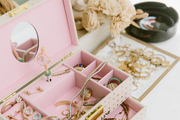 A detail of a pink jewelry box.