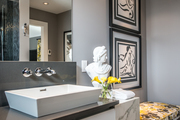 A contemporary gray bathroom with a yellow accent.
