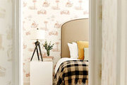 A guest room at the Palihouse Santa Monica with toile wallpaper and a cube side table