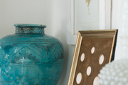 A detail of a console table with decorative objects.