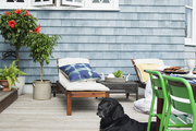 A backyard deck furnished for summer entertaining