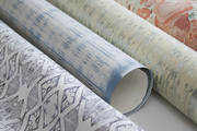 An array of papers suitable for walls or dressmaking
