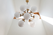 A ceiling light with gold accents.