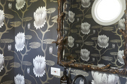 Emily Current's bathroom features floral wallpaper.
