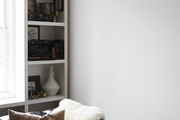 A small bookshelf unit next to a couch.